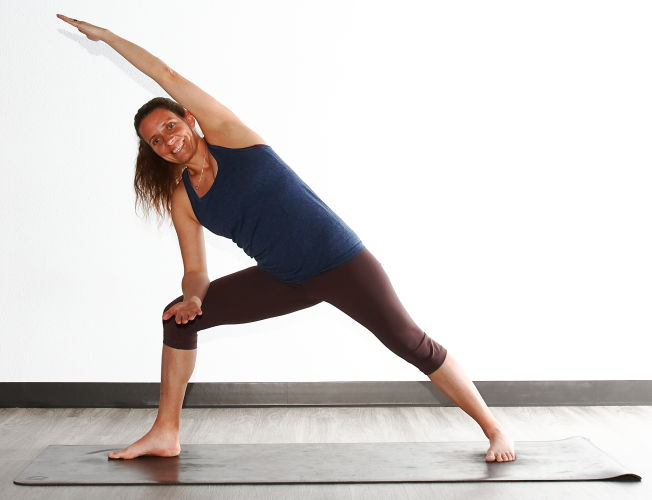 Beth Marek performing Reverse Warrior pose